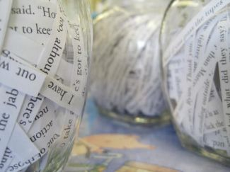 Clear jars filled with shredded paper