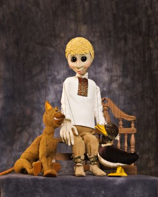 photo of puppet of Peter from Peter and the Wolf, flanked by wolf and duck puppets; photo from Fratello Marionettes