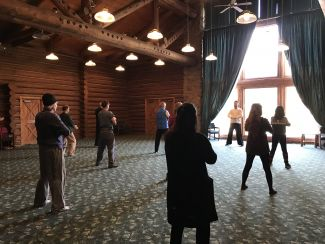 Gregory McDonald leading a class on Qi Gong in an Alpine-style studio