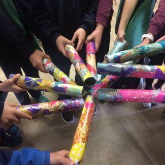 kids holding rainbow kaleidoscopes in a circle
