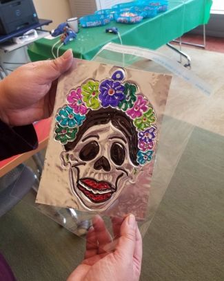 photo of a repujado of a calavera skull from a program by Rachel-Anne Palacios