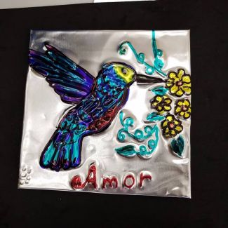 """photo of a repujado with a hummingbird and the word """"amor"""""""