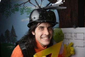 photo of actor in hard hat playing Mr. Ribble