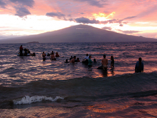 Native Hawaiians in the surf in Hawaii.CPhoto credit 2013, Christopher McLeod