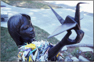 "photo of statue of Sadako Sasaki; ""Sadako and Her Paper Crane"" by Great Beyond on Flickr / CC BY 2.0"