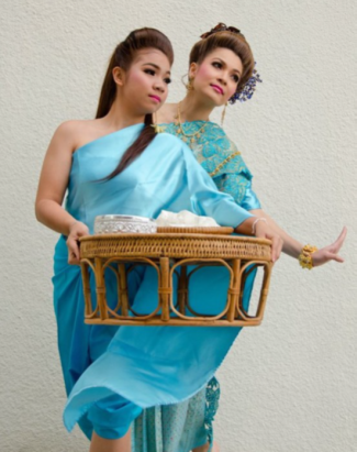 two TCC dancers in blue costumes