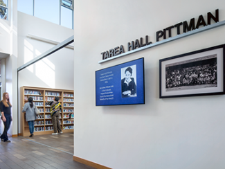 Tarea Hall Pittman South Branch Library Interior photo of signage honoring Tarea Hall Pittman