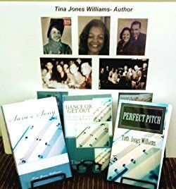 Photos and copies of Tina Jones Williams books arranged on a table