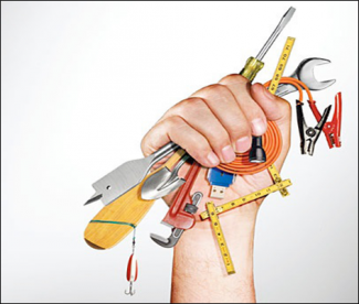Woman's hand holding up a fist full of tools