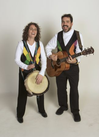 photo of musicians Jenny and David Heitler-Klevans playing drum and guitar