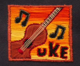 photo of embroidered patch with a ukulele and musical notes on it; Ukulele Style by Emily Moe licensed under CC BY-ND 2.0