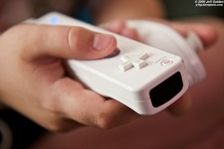 Hand holding a Wii game controller - Image Attributed to jeff_golden (http://www.flickr.com/photos/jeffanddayna) CC BY-NC-SA 2.0