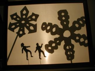 photo of scene from Shadows in the Snow shadow puppet program