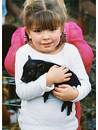child with piglet