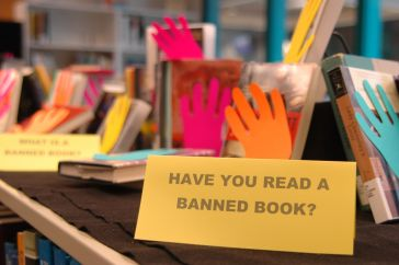 "Banned Books with sign ""Have you read a banned book?"" Photo by Flickr User CCAC North Library."