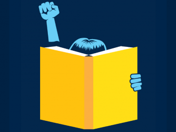 A person reading and holding a fist in the air.