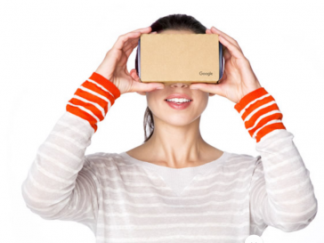 Woman holding a Google Cardboard Virtual Reality Headset