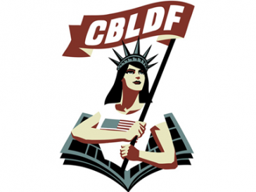 Comic book statue of liberty emerging from a comic book holding a flag with letters CBDLDF