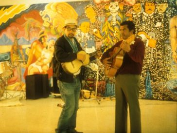 José Montoya and Esteban Villa with their guitars at the Royal Chicano Air Force Mural Show, held at the Robert Else Gallery, Ca
