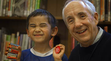 Smiling boy with his first library card