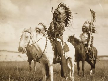 3 Mounted Sioux with headdress