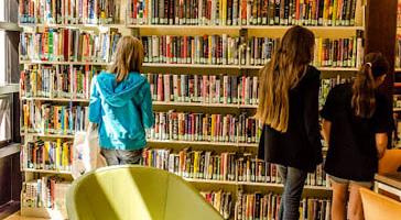 Teens browsing shelves at North Branch.