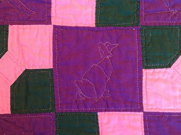 Quilt with stitched goose.
