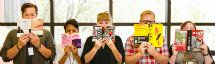 Five people peering over the tops of books they are reading.
