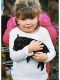 photo of little girl holding a small pig